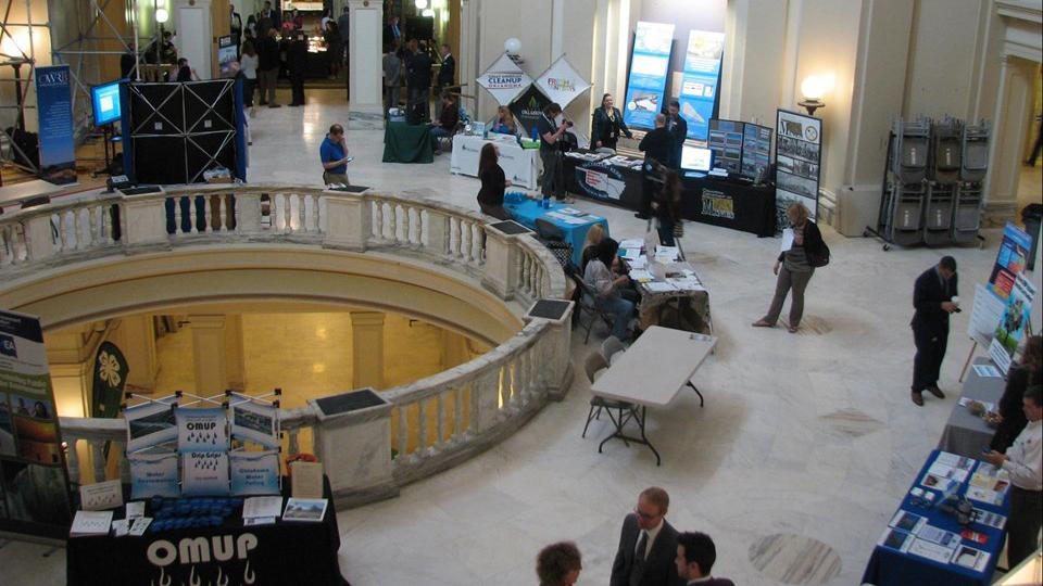 overhead view of tables with convention materials and banners for the event